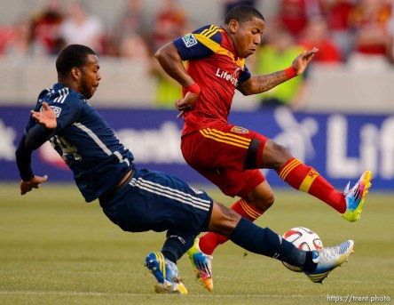 Trent Nelson | The Salt Lake Tribune Real Salt Lake's Joao Plata (8) and Vancouver's Carlyle Mitchell (24) race for the ball as Real Salt Lake hosts Vancouver Whitecaps FC at Rio Tinto Stadium in Sandy, Saturday July 19, 2014.