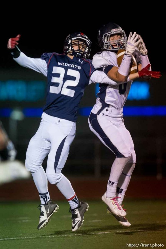 Trent Nelson | The Salt Lake Tribune Corner Canyon's Jake Cahoon makes a pick ahead of Woods Cross's James Gilbert as Woods Cross hosts Corner Canyon High School football, in Woods Cross, Wednesday October 15, 2014.