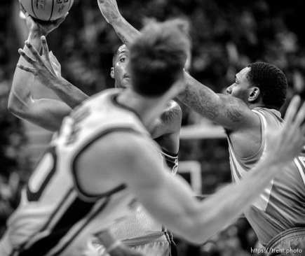 Trent Nelson | The Salt Lake Tribune Utah Jazz center Derrick Favors (15) looks to pass to Utah Jazz guard Gordon Hayward (20) as the Utah Jazz host the Houston Rockets, NBA basketball at EnergySolutions Arena in Salt Lake City, Wednesday October 29, 2014.