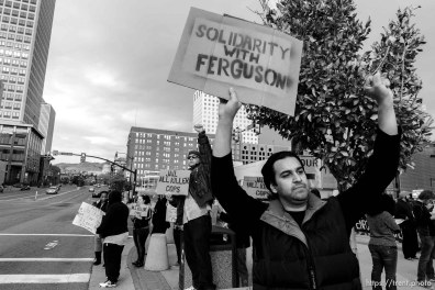Trent Nelson | The Salt Lake Tribune Protesters gather in front of the Federal Building as approximately 200 people turned out for a rally to protest police brutality in Salt Lake City, Saturday November 29, 2014. moshen mortazavi