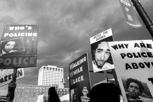 Trent Nelson | The Salt Lake Tribune Protesters gather in front of the Federal Building as approximately 200 people turned out for a rally to protest police brutality in Salt Lake City, Saturday November 29, 2014. darrien hunt
