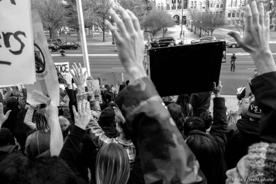 Trent Nelson | The Salt Lake Tribune Protesters hold their hands over their heads in front of the Matheson Courthouse as approximately 200 people turned out for a rally to protest police brutality in Salt Lake City, Saturday November 29, 2014.