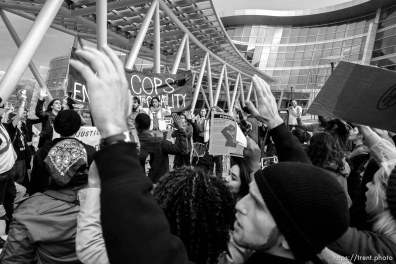 Trent Nelson | The Salt Lake Tribune Protesters hold their hands over their heads in front of the Salt Lake City public safety building as approximately 200 people turned out for a rally to protest police brutality in Salt Lake City, Saturday November 29, 2014.