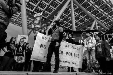 Trent Nelson | The Salt Lake Tribune Protesters in front of the Salt Lake City public safety building as approximately 200 people turned out for a rally to protest police brutality in Salt Lake City, Saturday November 29, 2014.