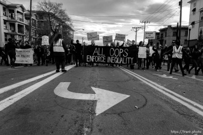 Trent Nelson | The Salt Lake Tribune Protesters march, blocking traffic as approximately 350 people turned out for a rally to protest police brutality in Salt Lake City, Saturday November 29, 2014.