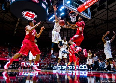 Trent Nelson | The Salt Lake Tribune Utah Utes guard Kenneth Ogbe (25) passes to forward Chris Reyes (20) as Alabama State Hornets guard Bobby Brown (5) defends as the University of Utah Utes host the Alabama State Hornets, college basketball at the Huntsman Center in Salt Lake City, Saturday November 29, 2014.