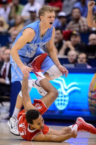 Trent Nelson | The Salt Lake Tribune Brigham Young Cougars guard Tyler Haws (3) takes a foot to the guy from Utah Utes guard Brandon Taylor (11) as BYU hosts Utah, college basketball at the Marriott Center in Provo, Wednesday December 10, 2014. A foul was called on Haws.