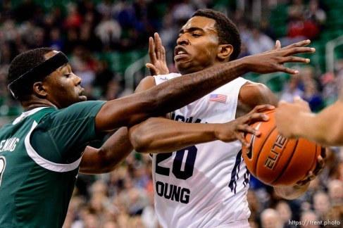 Trent Nelson | The Salt Lake Tribune Brigham Young Cougars guard Anson Winder (20) drives into Hawaii Warriors guard Isaac Fleming (0) as BYU faces Hawaii, college basketball at EnergySolutions Arena in Salt Lake City, Saturday December 6, 2014.