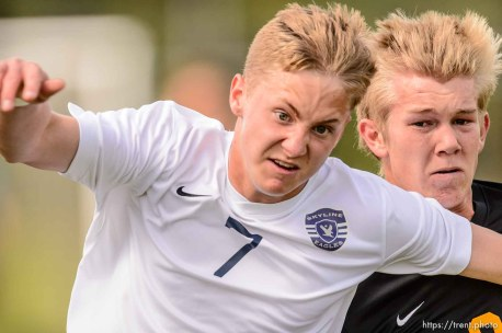 Trent Nelson | The Salt Lake Tribune Skyline's Hunter Kone (7) and Wasatch's Hunter Knight (3) race for the ball in a first round Class 4A soccer state game between Wasatch and Skyline High School, in Salt Lake City, Wednesday May 13, 2015.