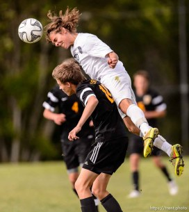 Trent Nelson | The Salt Lake Tribune Skyline's Tyler Kalakish (29) heads the ball in a first round Class 4A soccer state game between Wasatch and Skyline High School, in Salt Lake City, Wednesday May 13, 2015.