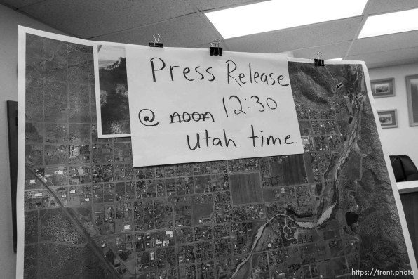 Trent Nelson | The Salt Lake Tribune map, sign, flash flood press conference at colorado city hall, Tuesday September 15, 2015. Eight people had died and five remained missing Tuesday morning, the day after an SUV and a van were washed off a road during a flash flood in this polygamous Utah-Arizona border community