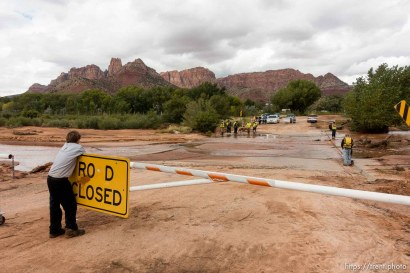 Trent Nelson | The Salt Lake Tribune Hildale Street was closed Tuesday September 15, 2015, the day after a flash flood killed nine people (with four still missing) when an SUV and a van were washed off a road during a flash flood in this polygamous Utah-Arizona border community.