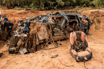 Trent Nelson | The Salt Lake Tribune A car seat on the ground at the spot in a Hildale wash Tuesday September 15, 2015 where two vehicles ended up after being washed away in a flash flood. Nine people died (with four still missing) when the SUV and van were washed off a road during a flash flood in this polygamous Utah-Arizona border community.