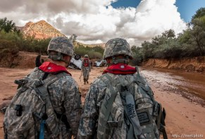 Trent Nelson | The Salt Lake Tribune Members of the Utah National Guard search the Short Creek Wash in Hildale, Wednesday September 16, 2015. The Utah National Guard and law enforcement on Wednesday resumed searching for the last known victim of a flash flood that tore through this polygamous border town home to followers of Warren Jeffs, leaving 13 dead and three injured, all of them women and children.