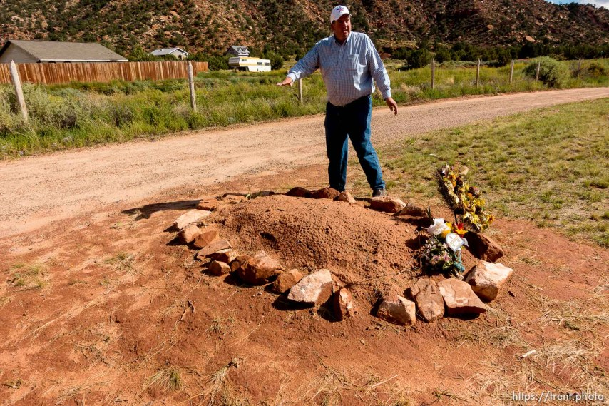 Trent Nelson | The Salt Lake Tribune Dee Barlow stands over Walter Steed's grave at the Isaac W Carling Memorial Park Cemetery in Colorado City, Arizona, Wednesday September 16, 2015.