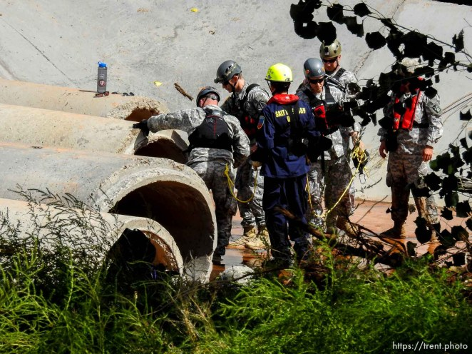 Trent Nelson | The Salt Lake Tribune Searchers from the Utah National Guard and Task Force One search a culvert along the Short Creek Wash in Colorado City, Arizona, Wednesday September 16, 2015. The Utah National Guard and law enforcement on Wednesday resumed searching for the last known victim of a flash flood that tore through this polygamous border town home to followers of Warren Jeffs, leaving 13 dead and three injured, all of them women and children.