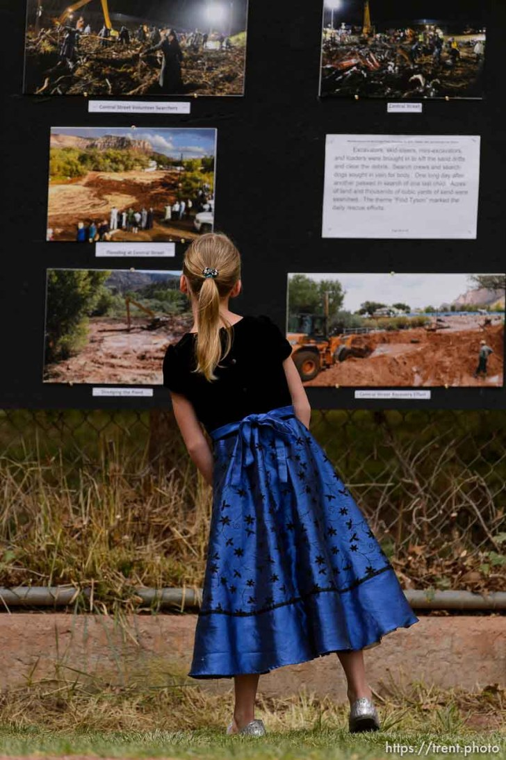 Trent Nelson | The Salt Lake Tribune at a memorial for the 13 (and 1 still missing) victims of a September 14th flash flood. The memorial was held in Maxwell Park in Hildale, Saturday September 26, 2015.