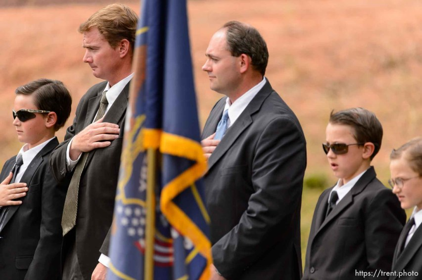 Trent Nelson | The Salt Lake Tribune at a memorial for the 13 (and 1 still missing) victims of a September 14th flash flood. The memorial was held in Maxwell Park in Hildale, Saturday September 26, 2015. On the diaz - Joseph Jessop, Jr., Joseph Jessop, Sheldon Black, Black's two sons.