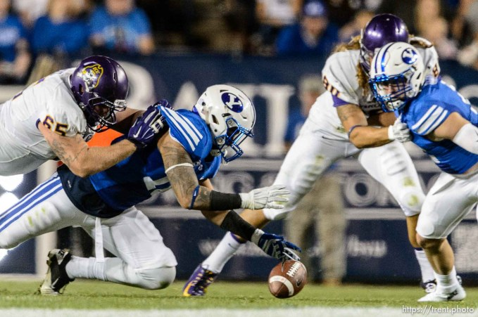 Trent Nelson | The Salt Lake Tribune Brigham Young Cougars linebacker Sione Takitaki (16) recovers a fumble as BYU hosts East Carolina, college football at LaVell Edwards Stadium in Provo, Saturday October 10, 2015.