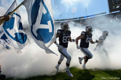 Trent Nelson | The Salt Lake Tribune cougars take field through fog and flags as BYU hosts Wagner, NCAA football at LaVell Edwards Stadium in Provo, Saturday October 24, 2015.