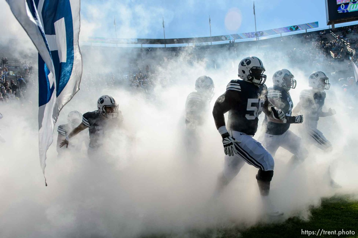 Trent Nelson | The Salt Lake Tribune BYU players storm out of the fog as BYU hosts Wagner, NCAA football at LaVell Edwards Stadium in Provo, Saturday October 24, 2015.