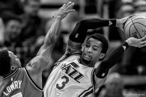 Trent Nelson | The Salt Lake Tribune Utah Jazz guard Trey Burke (3) looks to pass under pressure from Toronto Raptors guard Kyle Lowry (7) as the Utah Jazz host the Toronto Raptors, NBA basketball at Vivint Smart Home Arena in Salt Lake City, Wednesday November 18, 2015.