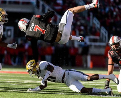 Trent Nelson | The Salt Lake Tribune Utah Utes quarterback Travis Wilson (7) flips over UCLA Bruins defensive back Tahaan Goodman (21) as the University of Utah hosts UCLA, NCAA football at Rice-Eccles Stadium in Salt Lake City, Saturday November 21, 2015.