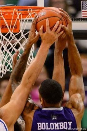 Trent Nelson | The Salt Lake Tribune Weber State's Joel Bolomboy pulls down a rebound as BYU faces Weber State, NCAA basketball at Vivant Smart Home Arena in Salt Lake City, Saturday December 5, 2015.