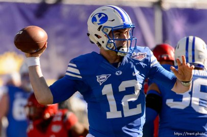 Trent Nelson | The Salt Lake Tribune Brigham Young Cougars quarterback Tanner Mangum (12) throws the ball as Utah faces BYU in the Royal Purple Las Vegas Bowl, NCAA football at Sam Boyd Stadium in Las Vegas, Saturday December 19, 2015.