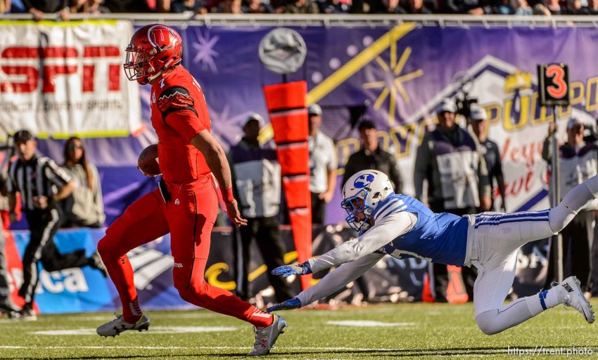 Trent Nelson | The Salt Lake Tribune Utah Utes quarterback Travis Wilson (7) runs for a touchdown as Utah faces BYU in the Royal Purple Las Vegas Bowl, NCAA football at Sam Boyd Stadium in Las Vegas, Saturday December 19, 2015.