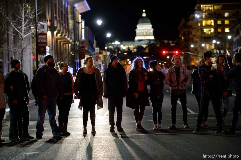 Trent Nelson | The Salt Lake Tribune Protesters occupy intersection of 100 South State Street, near the Wallace Bennett Federal Building to protest the police shooting of 17-year-old Abdi Mohamed on Saturday night, Monday February 29, 2016.