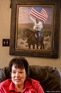 Trent Nelson   The Salt Lake Tribune Carol Bundy in the front room of the family's ranch home in Bunkerville, NV, Thursday April 14, 2016. A painting of her husband, Cliven Bundy, holding an American flag on horseback, hangs behind her.
