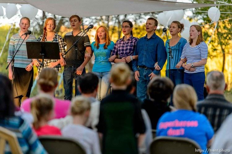 The El Capitan school glee class performs at a memorial service in Colorado City, AZ