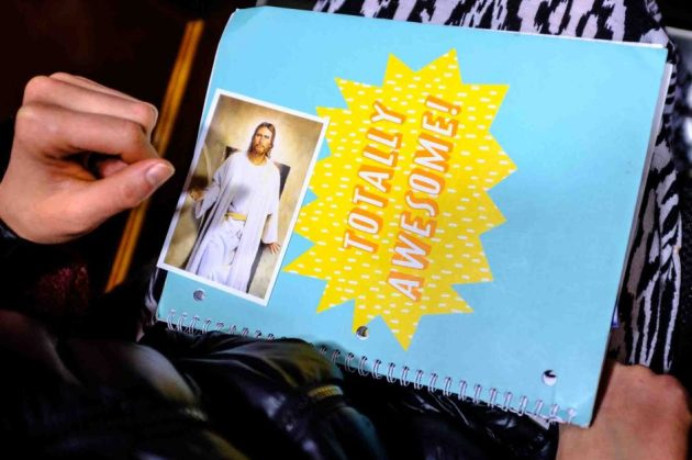 Trent Nelson   The Salt Lake Tribune A woman's notebook and a depiction of Jesus Christ, during the morning session of the 187th Annual General Conference at the Conference Center in Salt Lake City, Sunday April 2, 2017.