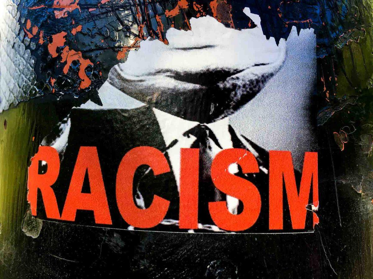 racism sticker, torn
