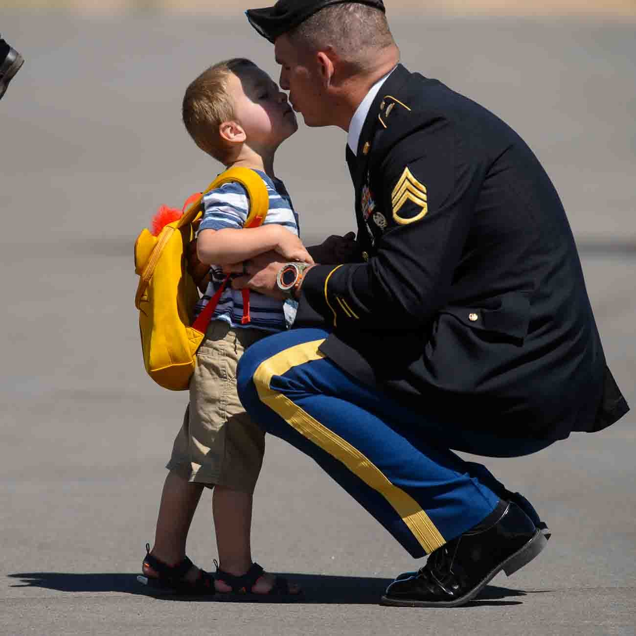 (Trent Nelson | The Salt Lake Tribune) Robert Barton kisses his father, Jesse Barton (cousin of Aaron Butler) while waiting for the arrival the body of fallen soldier Aaron Butler, who was killed last week in Afghanistan, at the Monticello Airport, Thursday August 24, 2017.