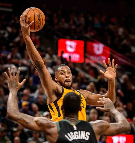 Utah Jazz forward Derrick Favors (15) reaches for the ball as the Utah Jazz host the Milwaukee Bucks, NBA basketball in Salt Lake City Saturday November 25, 2017.