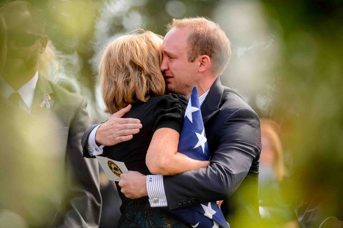 (Trent Nelson | The Salt Lake Tribune) Laura Butler embraces her son Nathan after the graveside service for one of her other sons, fallen soldier Aaron Butler, in Monticello Saturday August 26, 2017.