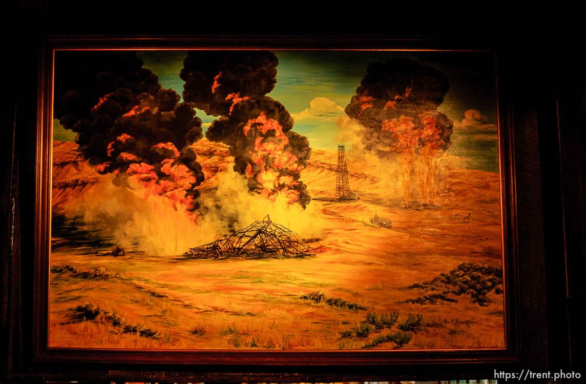 painting of burning oil rigs in the hotel.