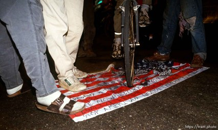 Desecrating the U.S. flag at Anti war Gulf War protests.