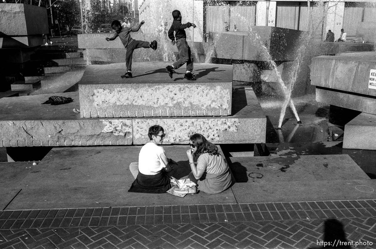 Kids playing karate in fountain