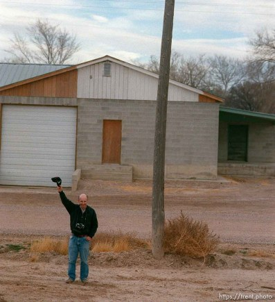 Man waves to the Governor's Centennial Train