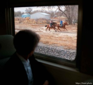 Horses chase the Governor's Centennial Train
