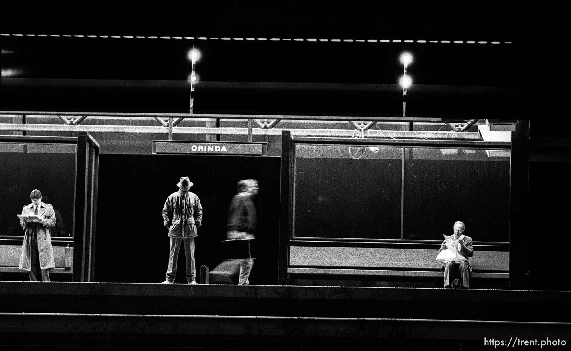 Commuters waiting for BART train before sunrise