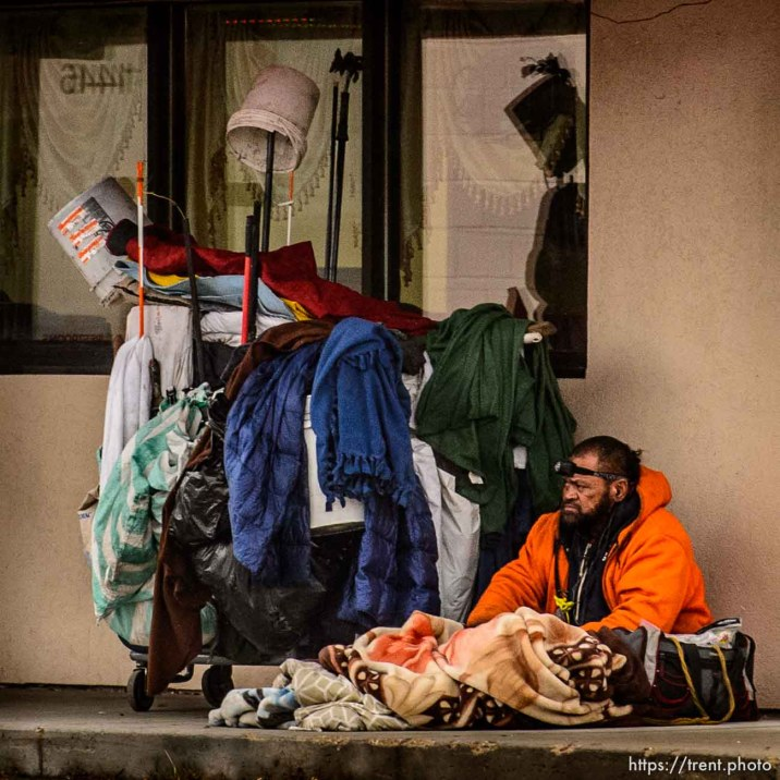 man and belongings camped in front of restaurant, Tuesday January 9, 2018.