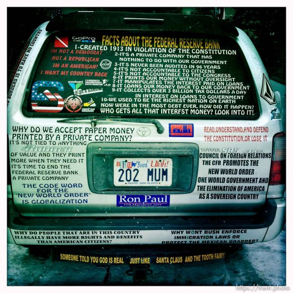 signs and bumper stickers on car, ron paul, federal reserve, constitution, new world order, etc