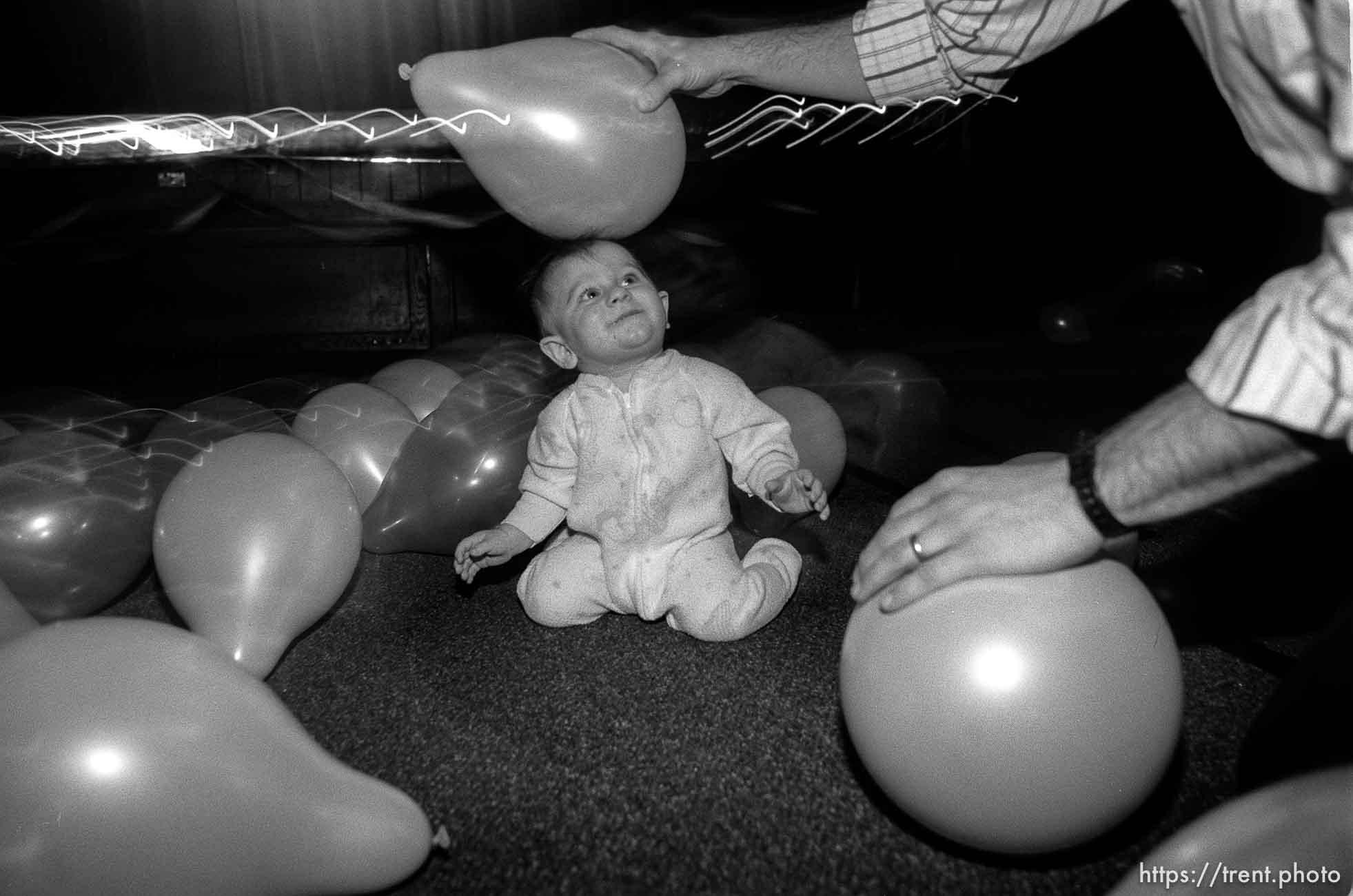 Balloon on baby's head