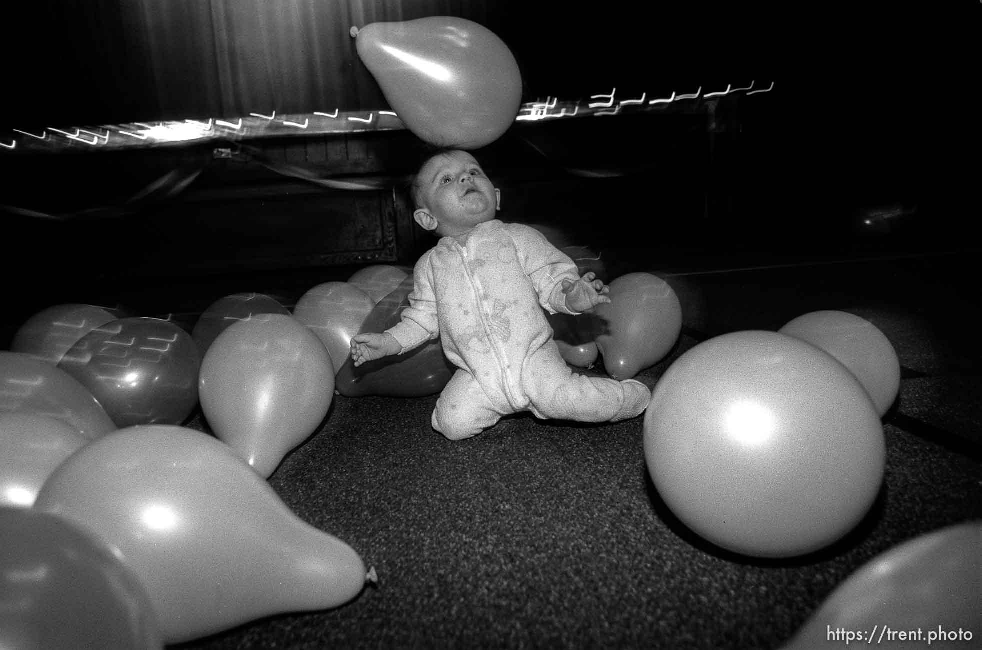 Kid with balloon on its head