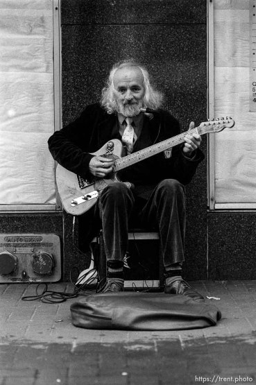 Guy on street with guitar