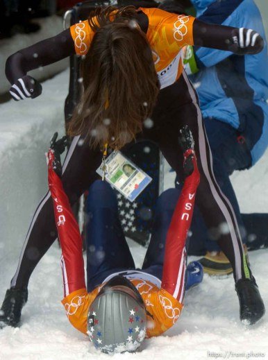USA skeleton athletes Lea Ann Parsley (top, silver medalist) and Tristan Gale (gold medalist) celebrate. Skeleton, Wednesday morning at the Utah Olympic Park, 2002 Olympic Winter Games.; 02.20.2002, 11:56:56 AM